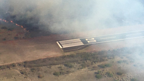 """The Maui Fire Department believes the fire started in Kahana, """"just above the airport."""""""