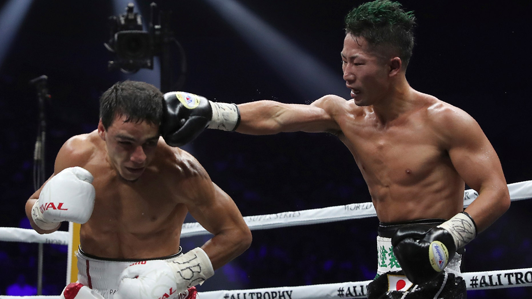 Japan's Takuma Inoue, right, sends a right to France's Nordine Oubaali in a 12th spin of their WBC universe bantamweight pretension compare in Saitama, Japan, Thursday, Nov. 7, 2019. Oubaali degraded Inoue by a unanimous decision. (AP Photo/Toru Takahashi)
