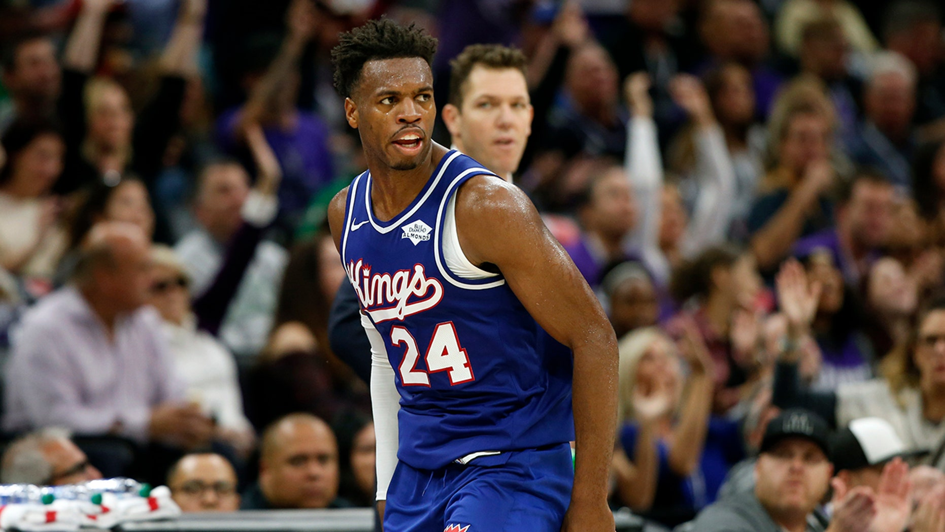 Sacramento Kings guard Buddy Hield runs down court after scoring a 3-point shoot in the closing minutes of the Kings 100-99 win over the Boston Celtics in an NBA basketball game in Sacramento, Calif., Sunday, Nov. 17, 2019. (AP Photo/Rich Pedroncelli)