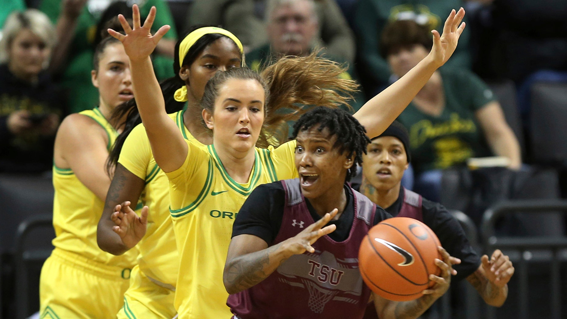 Texas Southern's Ciani Cryor, front, looks for an open teammate while under pressure from Oregon's Erin Boley, left, Ruthy Hebard and Taylor Chavez during the first quarter of an NCAA college basketball game in Eugene, Ore., Saturday, Nov. 16, 2019. (AP Photo/Chris Pietsch)