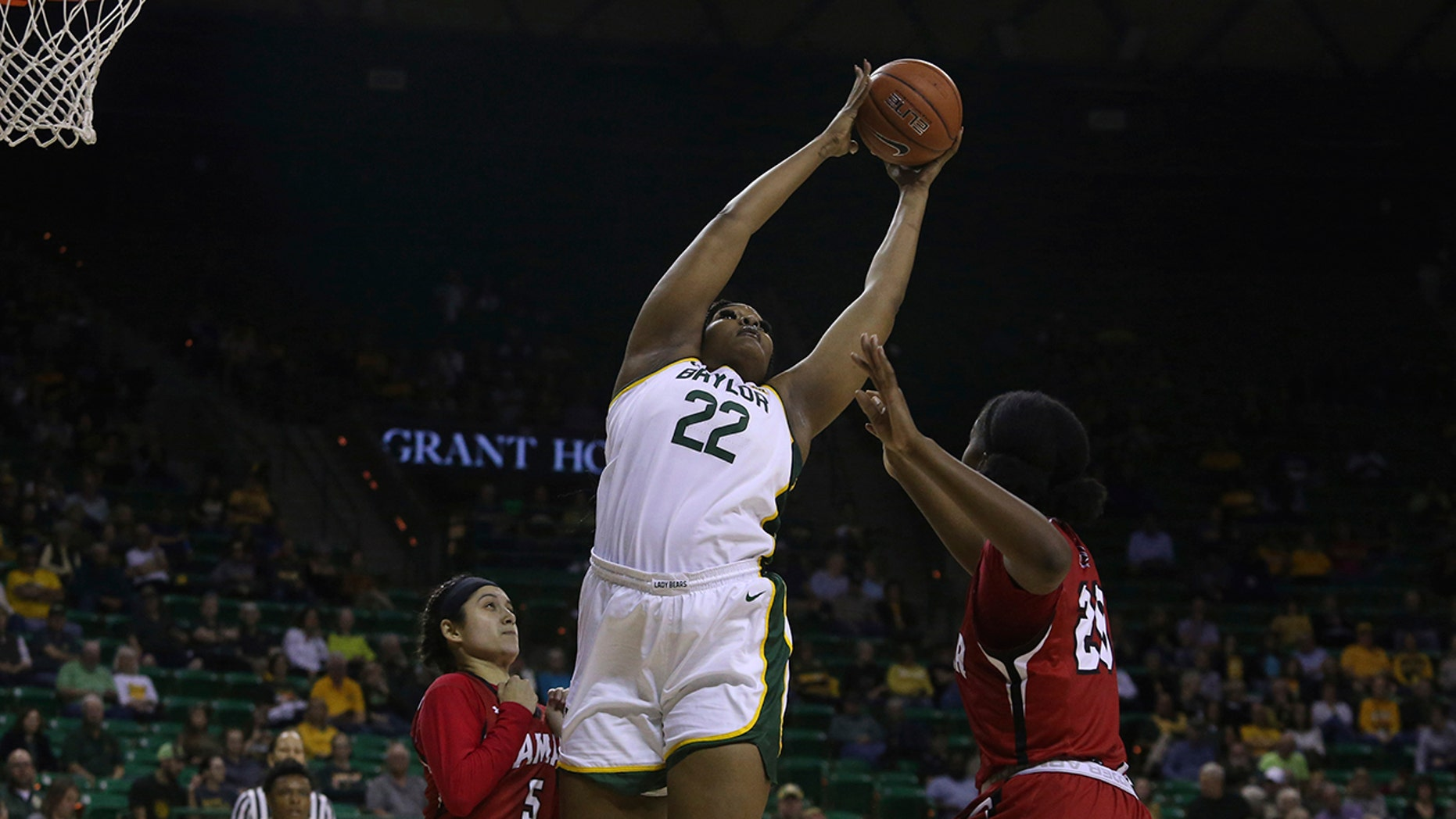 Baylor center Erin DeGrate (22) leaps for the ball against Lamar center Rikiah Cowart (20) and Lamar guard Amber Vidal (5) in the first half of an NCAA college basketball game, Thursday, Nov. 21, 2019, in Waco, Texas. (AP Photo/Jerry Larson)