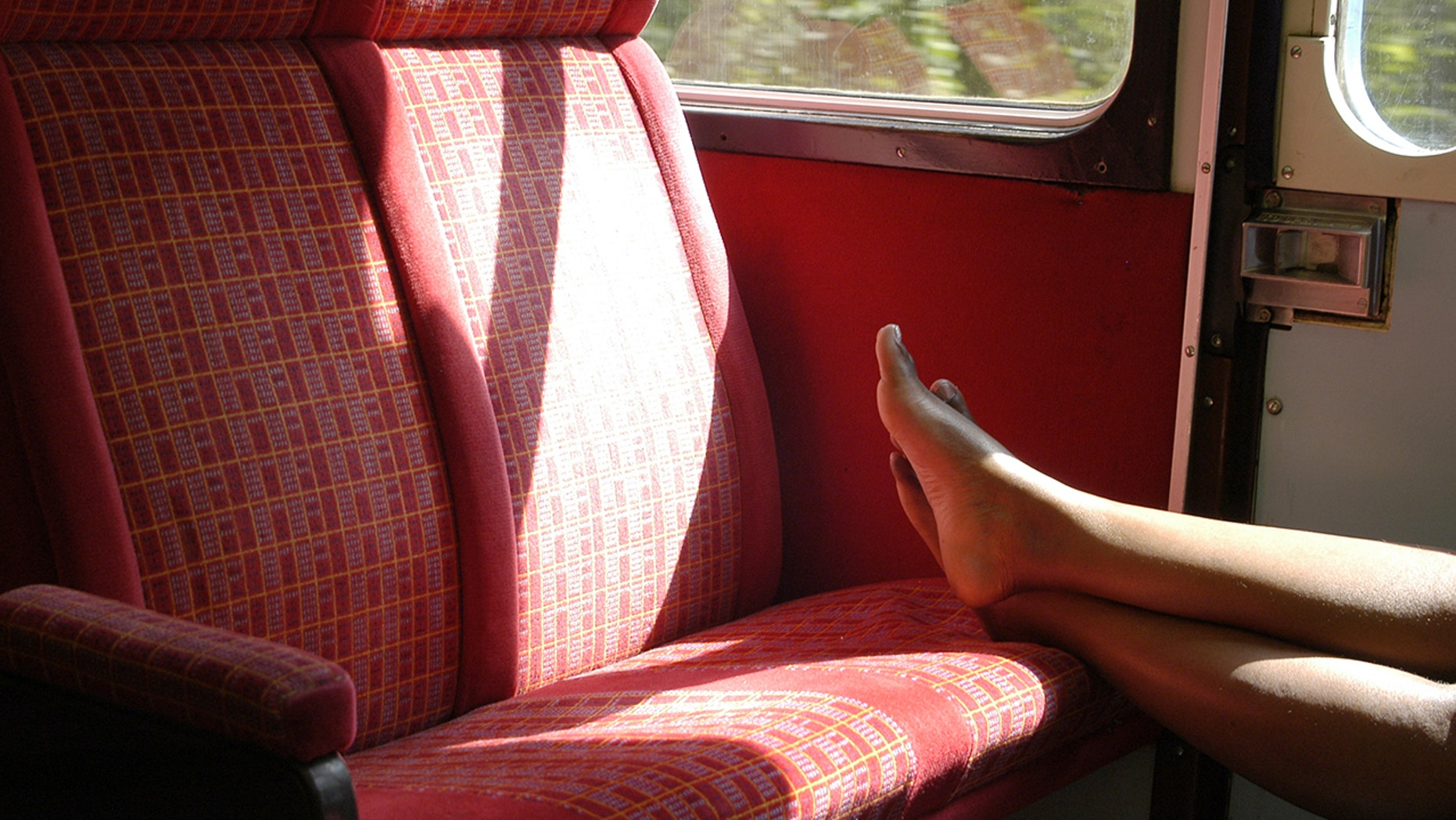 A London sportscaster called out a train passenger on Wednesday for putting their bare feet on empty seat. (Photo: iStock)