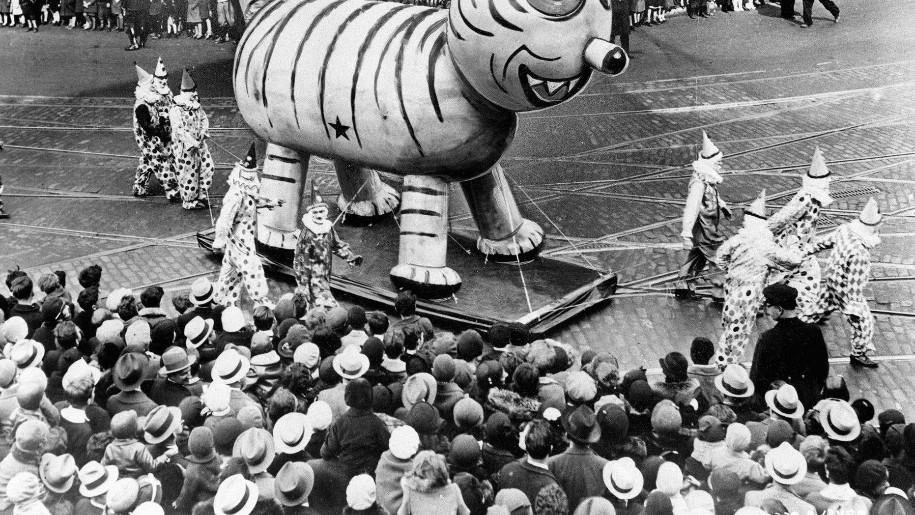 An outdoor float of a big cat makes its way down a street during the Thanksgiving Day Parade in New York City on Nov. 26, 1931. (AP Photo)