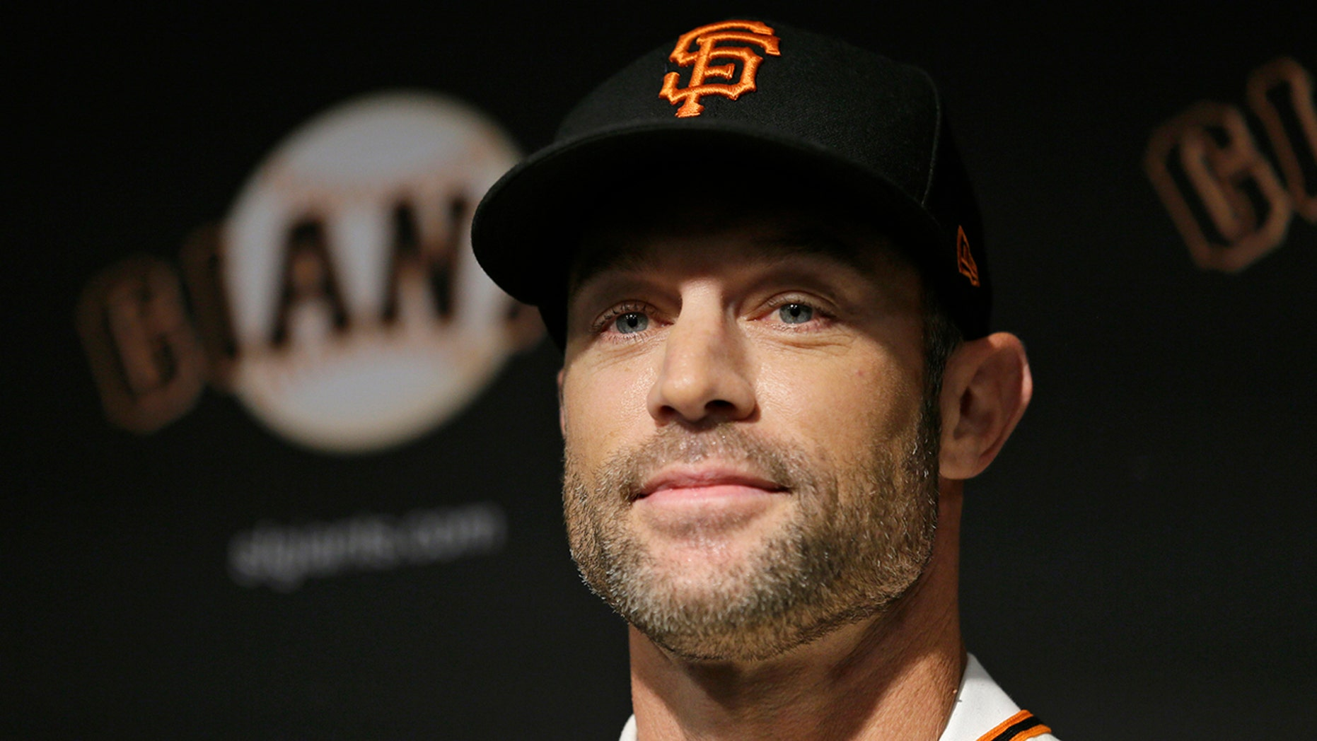 San Francisco Giants manager Gabe Kapler smiles after being introduced during a news conference at Oracle Park Wednesday, Nov. 13, 2019, in San Francisco. Gabe Kapler has been hired as manager of the San Francisco Giants, a month after being fired from the same job by the Philadelphia Phillies. Kapler replaces Bruce Bochy, who retired at the end of the season following 13 years and three championships with San Francisco. (AP Photo/Eric Risberg)