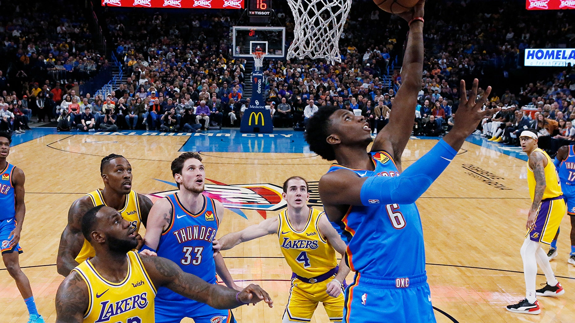 Oklahoma City Thunder guard Hamidou Diallo (6) shoots in front of Los Angeles Lakers forward LeBron James (23) and guard Alex Caruso (4) during the fist half of an NBA basketball game Friday, Nov. 22, 2019, in Oklahoma City. (AP Photo/Sue Ogrocki)