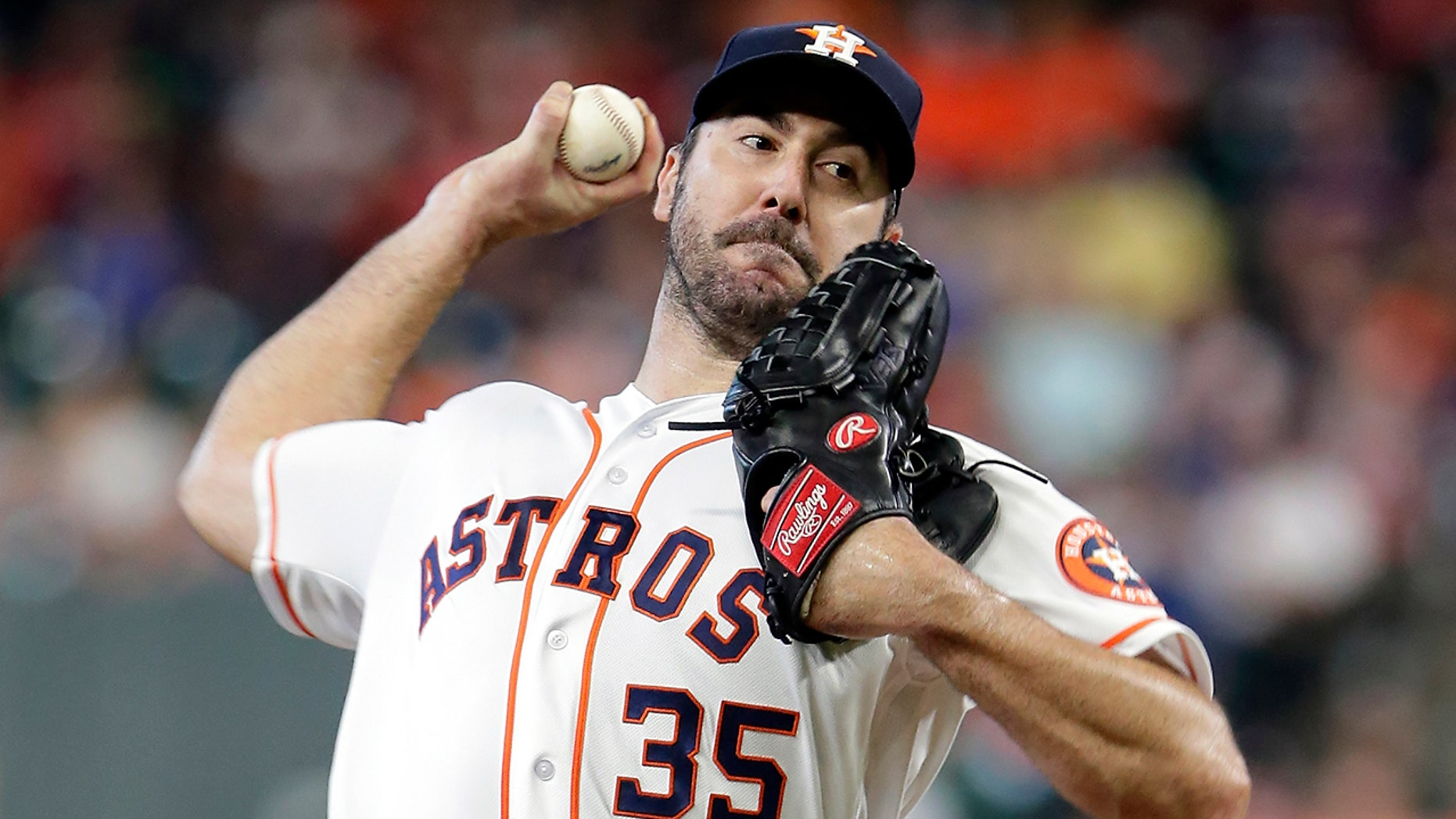 FILE - In this July 24, 2019, file photo, Houston Astros starting pitcher Justin Verlander throws to an Oakland Athletics batter during a baseball game in Houston. Verlander has been awarded his second AL Cy Young Award. (AP Photo/Michael Wyke, File)