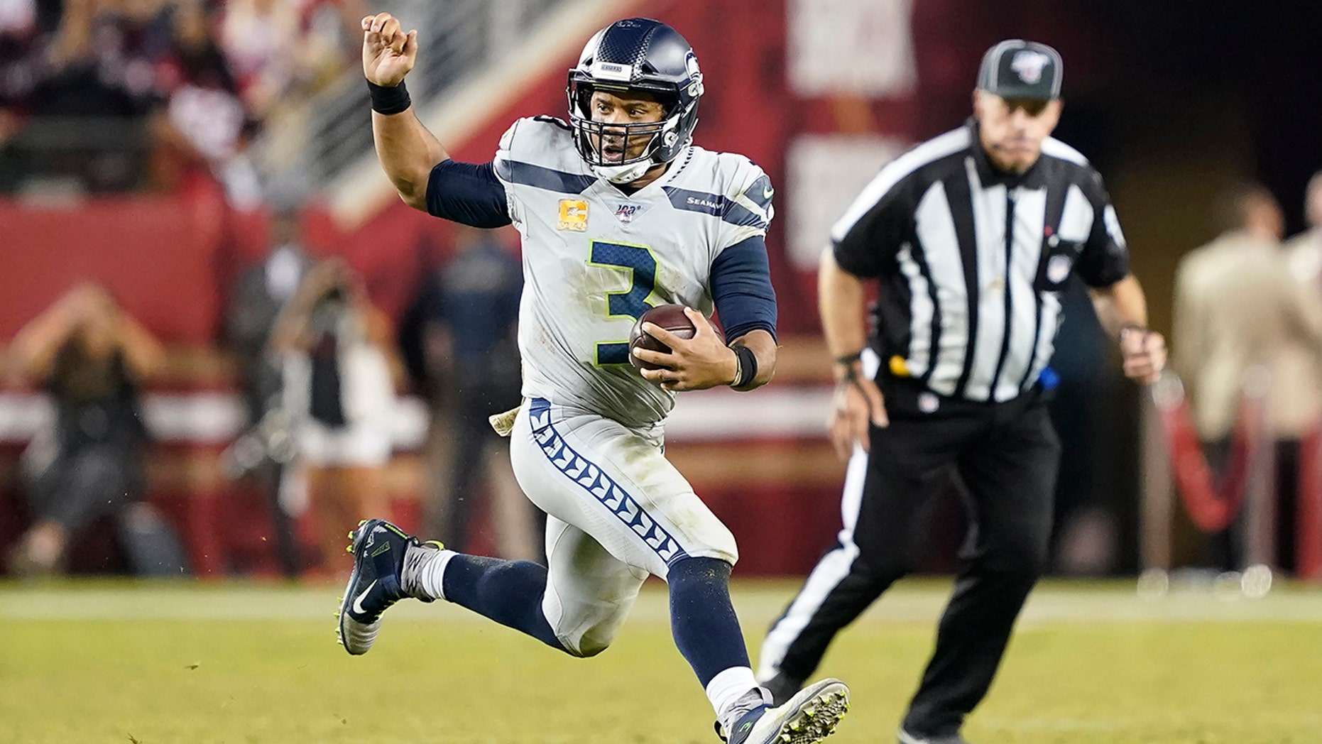 Seattle Seahawks quarterback Russell Wilson (3) runs a round opposite a San Francisco 49ers during a second half of an NFL football diversion in Santa Clara, Calif., Monday, Nov. 11, 2019. (AP Photo/Tony Avelar)