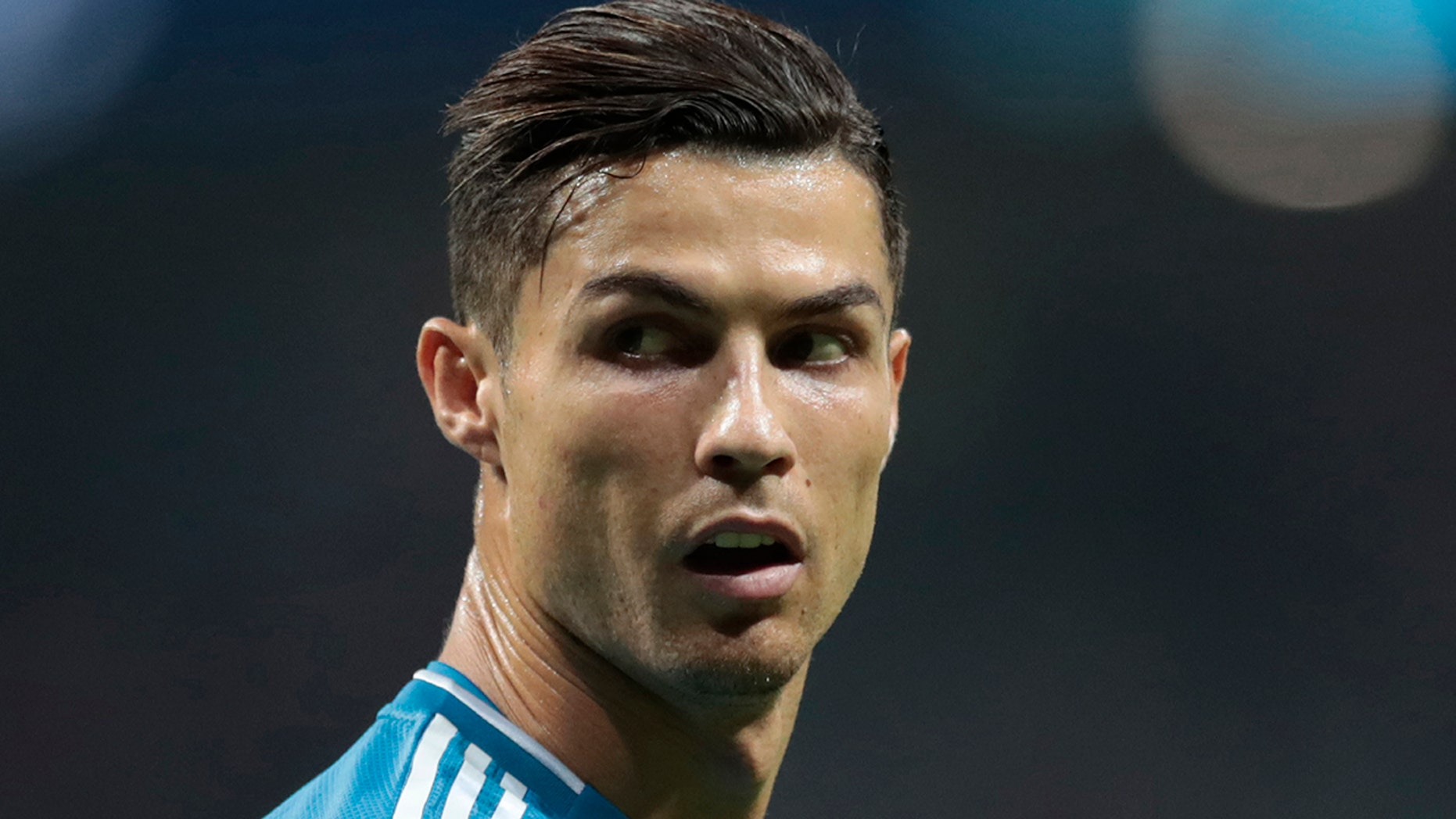 FILE - In this Sept. 18, 2019, file photo, Juventus' Cristiano Ronaldo looks back during the Champions League Group D soccer match between Atletico Madrid and Juventus at the Wanda Metropolitano stadium in Madrid, Spain. Cristiano Ronaldo's lawyers and attorneys for a Nevada woman accusing the soccer star of raping her in 2009 appeared Thursday, Nov. 7, 2019, before a federal magistrate judge who is new to the case. Kathryn Mayorga's lawsuit alleges she was coerced into a 2010 confidentiality agreement that paid her a $375,000 hush-money payment, and should be awarded more money. (AP Photo/Bernat Armangue, File)