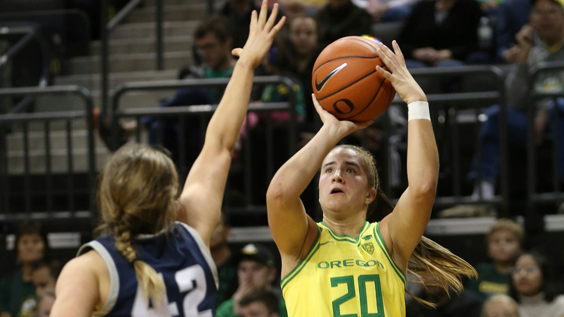 Oregon's Sabrina Ionescu, right, shots over Utah State's Taylor Franson during the second quarter of an NCAA college basketball game in Eugene, Ore., Wednesday, Nov. 13, 2019. (AP Photo/Chris Pietsch)