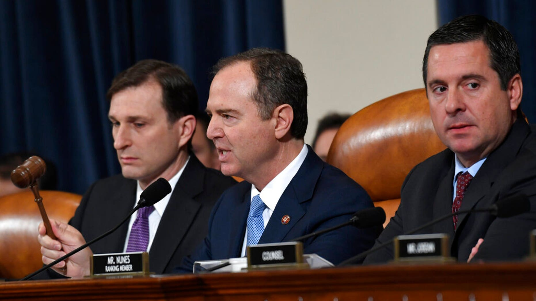 House Intelligence Committee Chairman Adam Schiff, D-Calif., center, flanked by House Democratic Counsel Daniel Goldman, left, and ranking member Devin Nunes, R-Calif. (AP Photo/Susan Walsh)