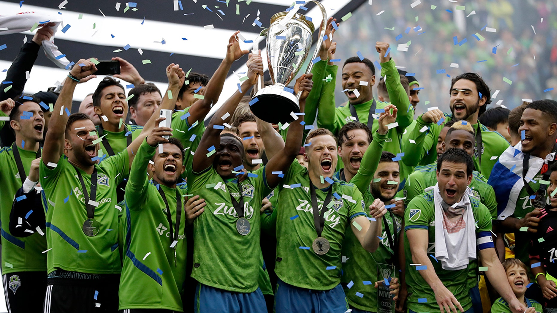 Seattle Sounders celebrate Sunday, Nov. 10, 2019, after the team beat the Toronto FC in the MLS Cup championship soccer match in Seattle. The Sounders won 3-1. (AP Photo/Elaine Thompson)