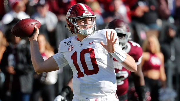 Alabama quarterback Mac Jones (10) rears back to pass downfield as a Mississippi State defender pursues during the second half of an NCAA college football game in Starkville, Miss., Saturday, Nov. 16, 2019. Alabama won 38-7. (AP Photo/Rogelio V. Solis)