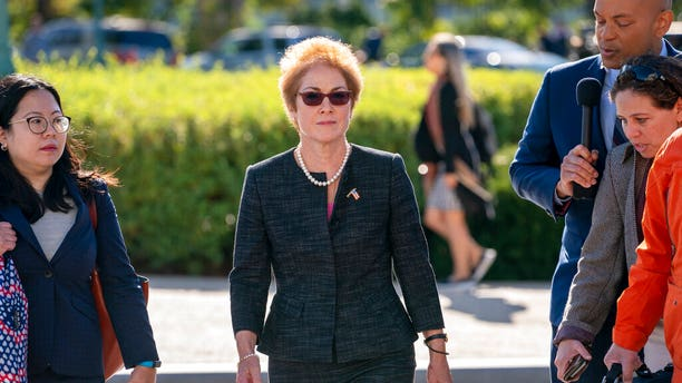 Former U.S. ambassador to Ukraine Marie Yovanovitch, center, arrives on Capitol Hill, Friday, Oct. 11, 2019, in Washington, to testify before congressional lawmakers as part of the House impeachment inquiry into President Donald Trump. (Associated Press)