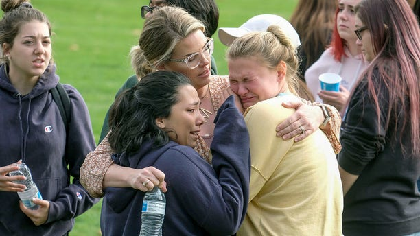 Students are comforted as they wait to be reunited with their parents following a shooting at Saugus High School that injured several people, Thursday, Nov. 14, 2019, in Santa Clarita, Calif.