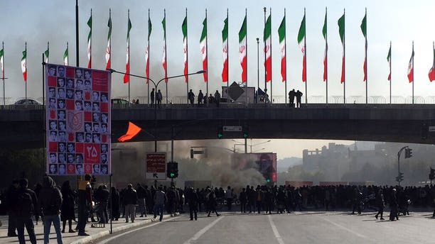 Smoke rises during a protest in the city of Isfahan Saturday. (AP Photo)