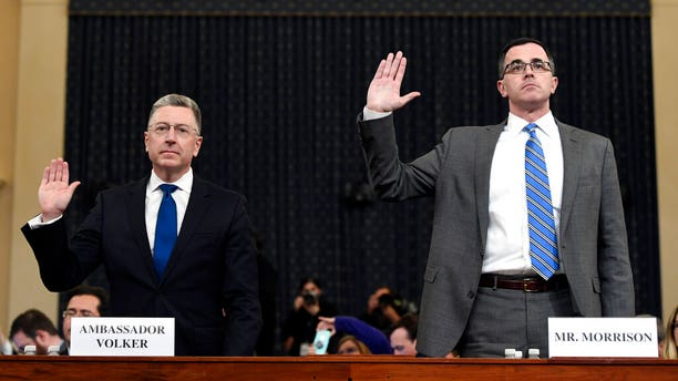 Ambassador Kurt Volker, left, former special envoy to Ukraine, and Tim Morrison, a former official at the National Security Council are sworn in to testify before the House Intelligence Committee.(AP Photo/Susan Walsh)