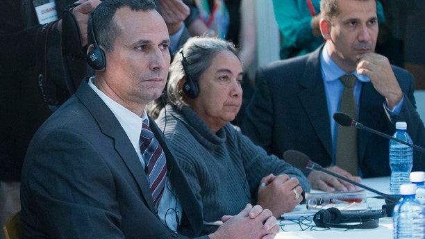FILE - In this March 22, 2016 file photo, Jose Daniel Ferrer, from left, Juana Mora Cedeno, and Antonio Rodiles, listen during their meeting with President Barack Obama at the U.S. Embassy, in Havana, Cuba. (AP Photo/Pablo Martinez Monsivais, File)