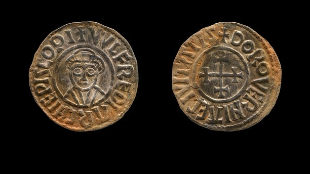 Two amateur British treasure-hunters, George Powell and Layton Davies have been imprisoned for stealing a hoard of 1,100-year-old Anglo-Saxon coins and jewelry valued at millions of dollars. Experts say the hoard, much of which is still missing, could shed new light on a period when Saxons were battling Vikings for control of England. (British Museum via AP)
