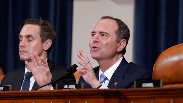House Intelligence Committee Chairman Adam Schiff, D-Calif., right, shown with committee staffer Daniel Noble at left, speaks at the conclusion of public impeachment hearings last month. (Associated Press)