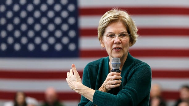 Democratic presidential candidate Sen. Elizabeth Warren, D-Mass., gestures as she speaks during a campaign stop in Manchester, N.H. Warren has introduced a bill that would revoke Medal of Honor for 20 U.S. soldiers who participated in the Wounded Knee Massacre of 1890.(AP Photo/Mary Schwalm)