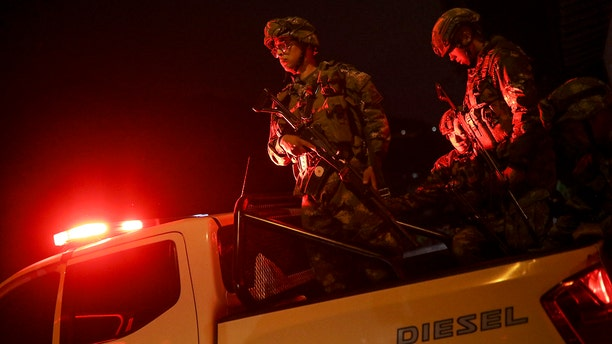 Soldiers leave from a military base to patrol the streets in Bogota, Colombia, Saturday, Nov. 23, 2019. Authorities in Colombia are maintaining a heightened police and military presence in the nation's capital following two days of unrest. (AP Photo/Ivan Valencia)