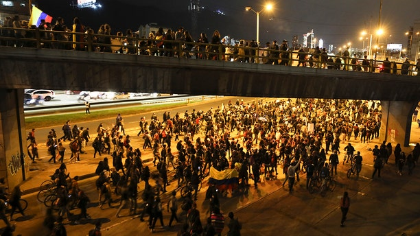 Anti-government demonstrators march in Bogota, Colombia, Monday, Nov. 25, 2019. Protests against the government of President Ivan Duque continued for the fifth consecutive day as students, women's groups and indigenous people marched through the center of the nation's capital. (AP Photo/Fernando Vergara)
