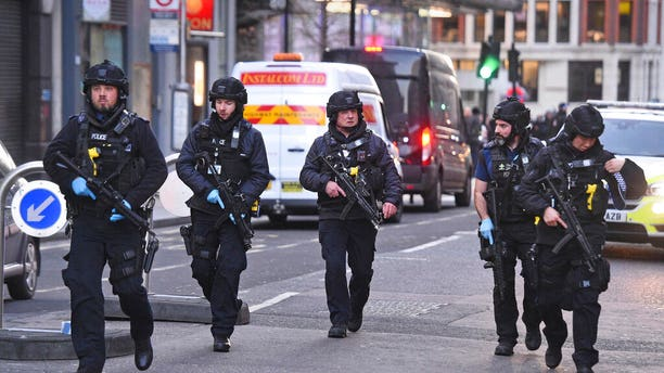Police on Cannon Street in London near the scene of an incident on London Bridge in central London following a police incident, Friday, Nov. 29, 2019. British police cleared the area around London Bridge in the center of the British capital on Friday after a stabbing and shooting incident that left several people injured. (Kirsty O'Connor/PA via AP)