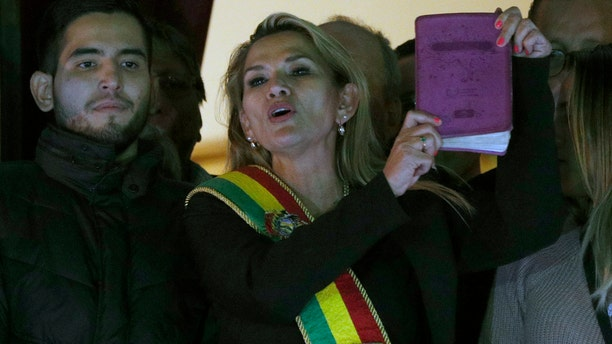 Opposition politician Jeanine Anez addresses the crowd from the balcony of the Quemado palace in La Paz after she declared herself interim president of Bolivia Tuesday. (AP Photo/Juan Karita)