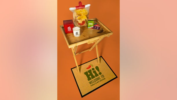 """The Chili's """"starter pack"""" comes with a rib-scented candle, a doormat, a TV tray, a trivia game and a chip bag clip."""
