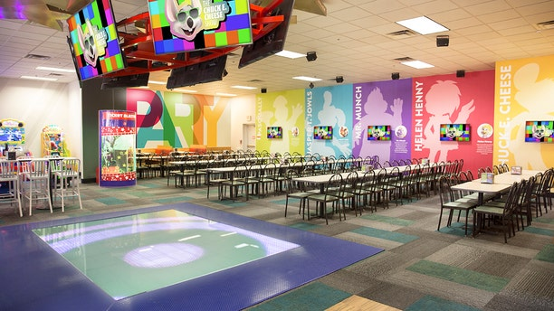 """As part of the chain's efforts to update its restaurants for a more modern age, Chuck E. Cheese locations throughout the nation will be ditching their robotic stage shows in favor of """"modern"""" dance floors that light up as guests move across it."""