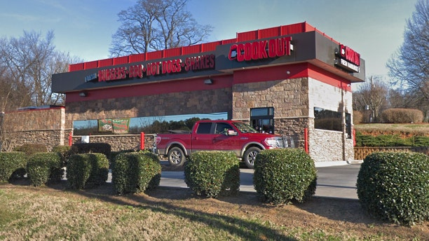 Taren Woods, a 10-year employee of Cook Out and the on-duty manager, claims she was fired after a cashier refused service to a police officer, even though the woman followed company policy by asking another cashier to take his order.