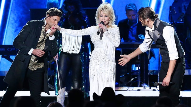Joel Smallbone and Luke Smallbone of For King & Country and Dolly Parton (M) perform onstage during the 53rd annual CMA Awards at the Music City Center on November 13, 2019 in Nashville, Tennessee. (Photo by Terry Wyatt/Getty Images,)