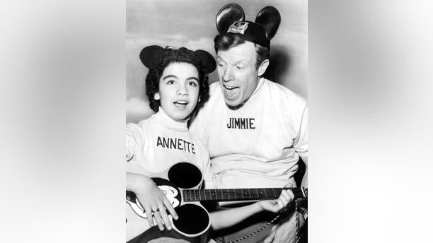 """Annette Funicello and Jimmie Dodd on """"The Mickey Mouse Club"""" television show, Hollywood, California, May 1956."""