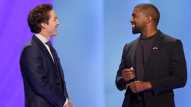 Kanye West, right, answering questions from Joel Osteen earlier Sunday in Houston. (Associated Press)