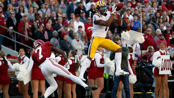 Ja'Marr Chase catches a touchdown pass from Joe Burrow for the first score of Saturday's game. (Associated Press)
