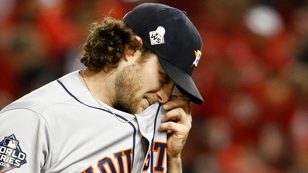 Houston Astros starting pitcher Gerrit Cole walks to the dugout after the third inning of Game 5 of the baseball World Series against the Washington Nationals Sunday, Oct. 27, 2019, in Washington. (AP Photo/Patrick Semansky)