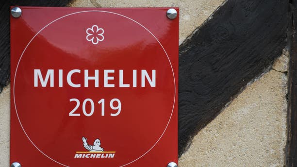 Inclusion in the Michelin Guide is often touted by restaurateurs — such as the restaurant seen debuting a 'Michelin 2019' sign in France, seen here — but Eo Yun-gwon calls the guide subjective, and claims he has repeatedly asked to be left off the list.