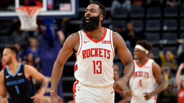 Houston Rockets guard James Harden (13) reacts after scoring a three-point basket in the second half of an NBA basketball game against the Memphis Grizzlies, Monday, Nov. 4, 2019, in Memphis, Tenn. (AP Photo/Brandon Dill)