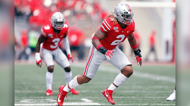 Chase Young has recorded 14 sacks in eight games for the Buckeyes this year. (AP Photo/Paul Vernon, File)