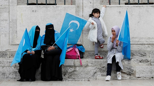 Uighur women hold East Turkestan flags at the courtyard of Fatih Mosque, a common meeting place for pro-Islamist demonstrators, during a protest against China, in Istanbul, Turkey, November 6, 2018. REUTERS/Murad Sezer