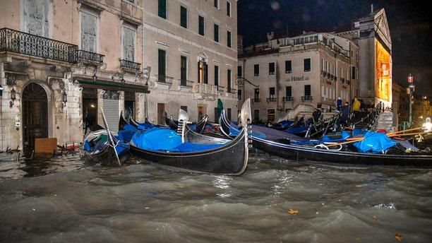 Stranded gondolas float adrift over the flooded banks, in Venice, Wednesday, Nov. 13, 2019.