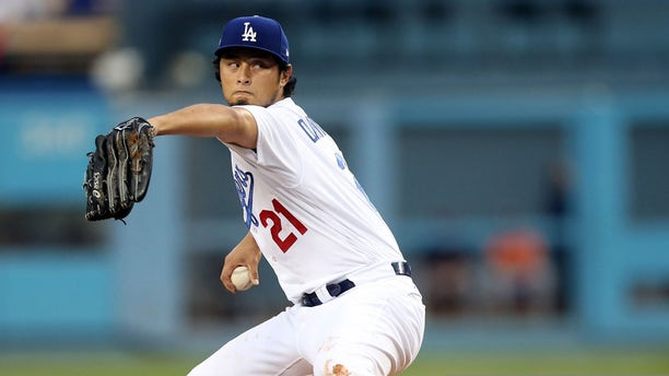 Yu Darvish #21 of the Los Angeles Dodgers pitches during Game 7 of the 2017 World Series against the Houston Astros at Dodger Stadium on Wednesday, Nov. 1, 2017 in Los Angeles. (Rob Tringali/MLB via Getty Images)