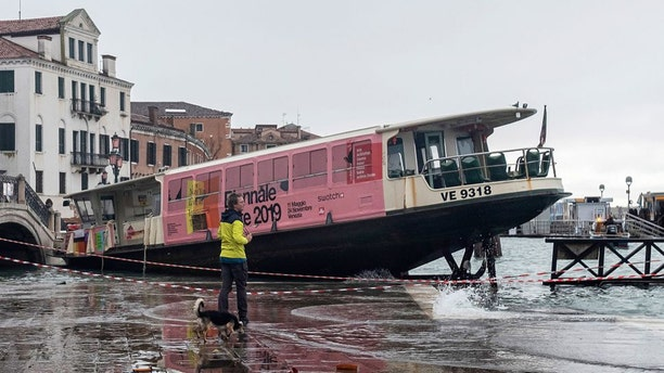 A water taxi sits moored near a flooded Venetian courtyard following the second-highest tide in the city's history. (Credit: Stefano Mazzola/Awakening/Getty)