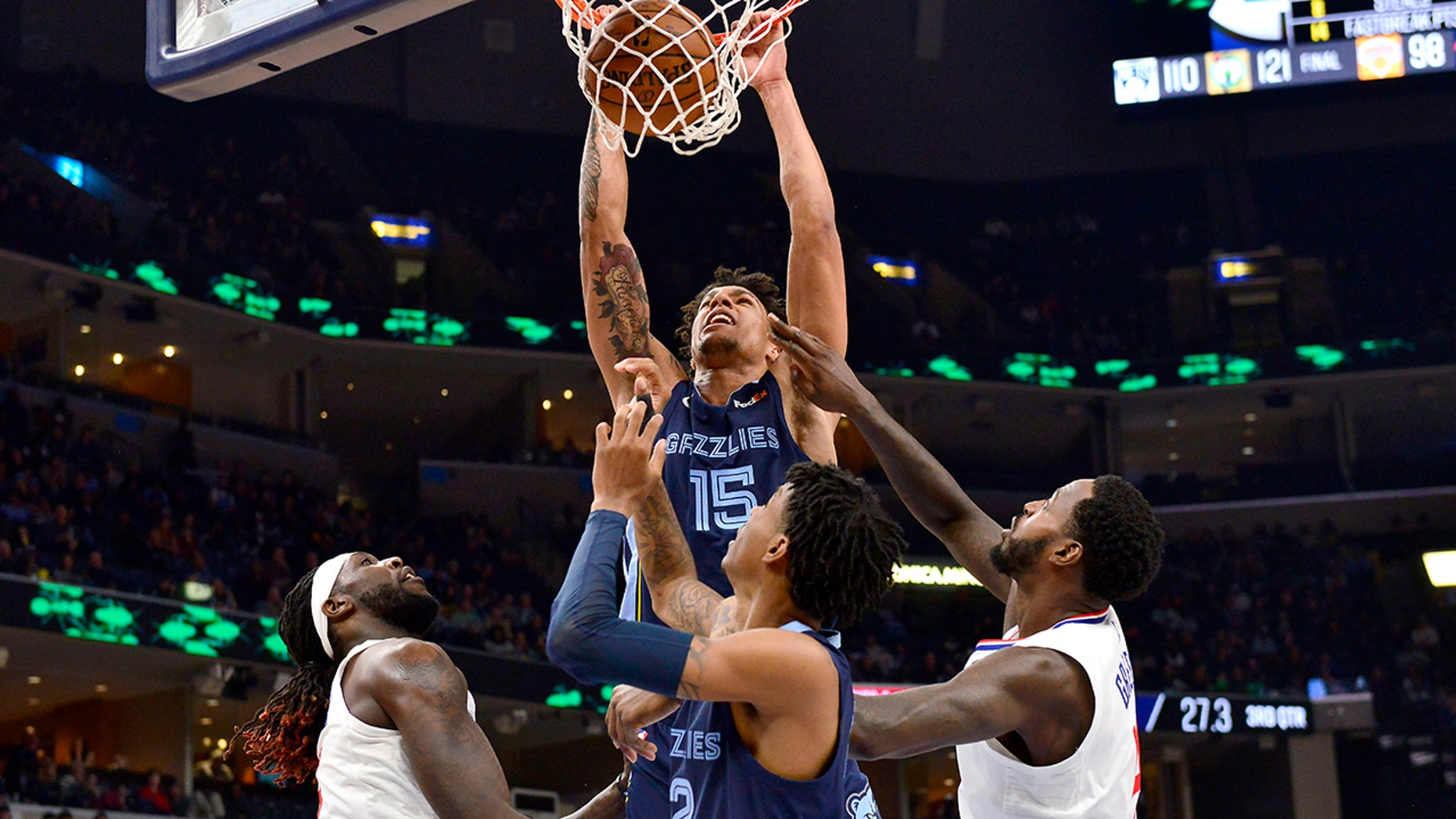 Memphis Grizzlies forward Brandon Clarke (15) dunks as Los Angeles Clippers forwards Montrezl Harrell, left, and JaMychal Green and Grizzlies guard Ja Morant watch during the second half of an NBA basketball game Wednesday, Nov. 27, 2019, in Memphis, Tenn. (AP Photo/Brandon Dill)