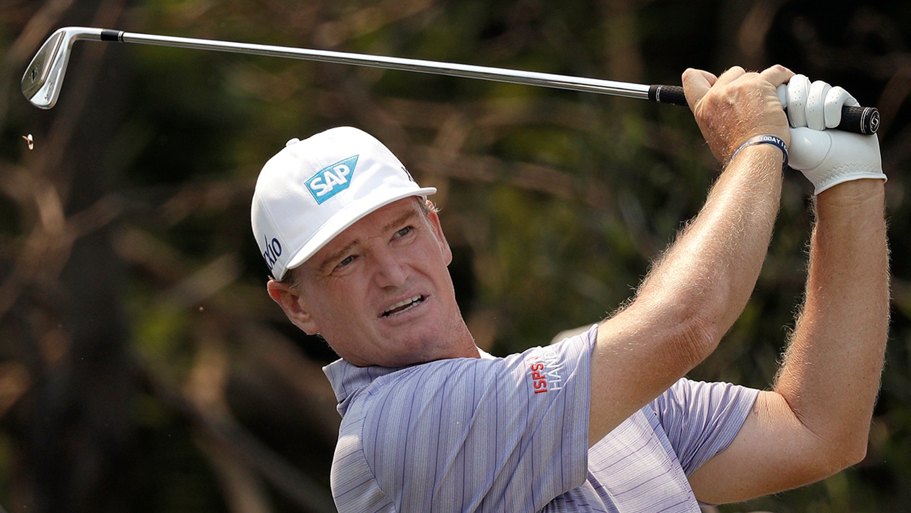 South Africa's Ernie Els tees off on a second hole during a Australian Open Golf Pro-AM in Sydney, Wednesday, Dec. 4, 2019. The Australian Open starts Thursday. (AP Photo/Rick Rycroft)