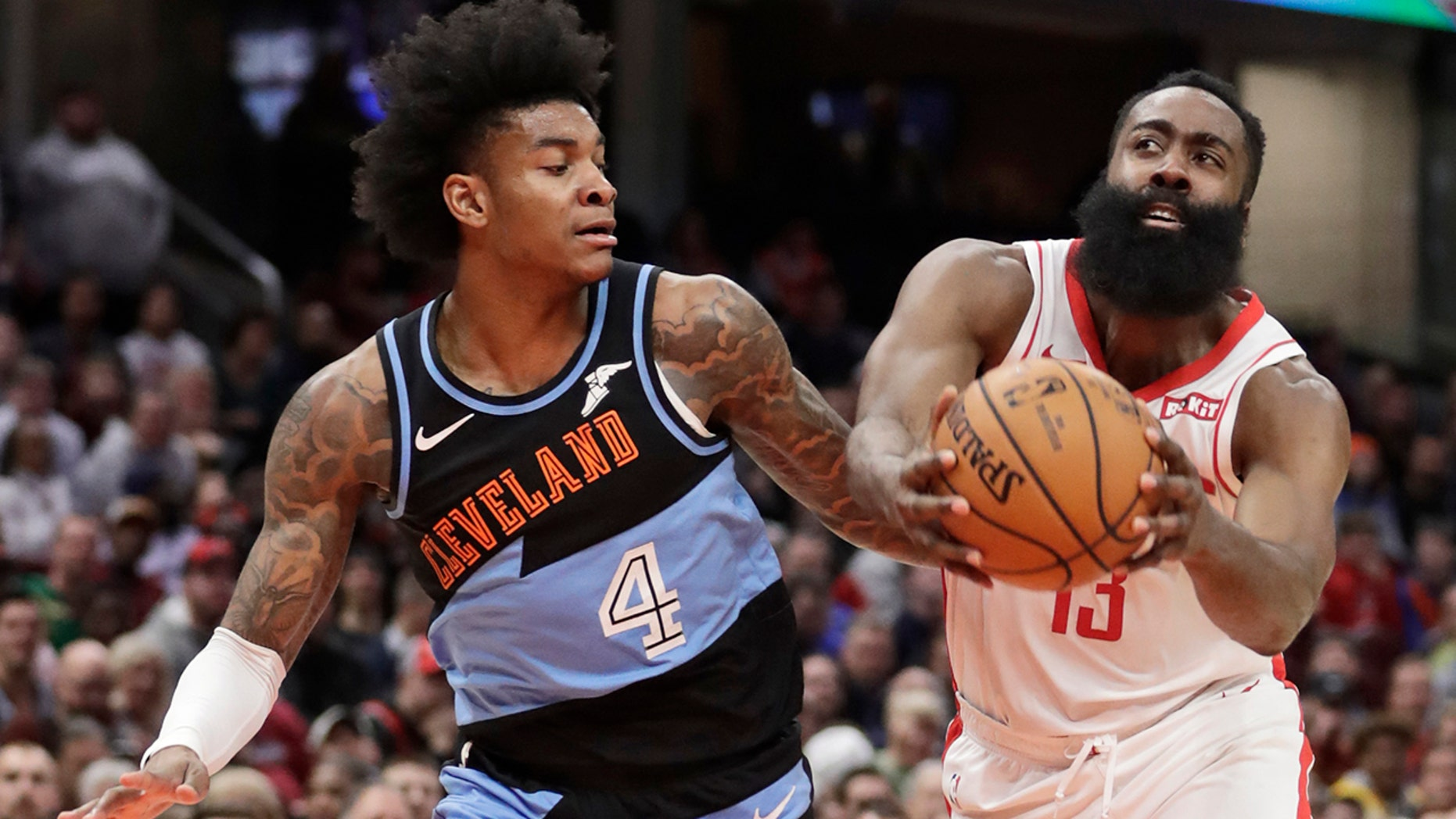 Houston Rockets' James Harden (13) drives past Cleveland Cavaliers' Kevin Porter Jr. (4) in the second half of an NBA basketball game, Wednesday, Dec. 11, 2019, in Cleveland. Houston won 116-110. (AP Photo/Tony Dejak)