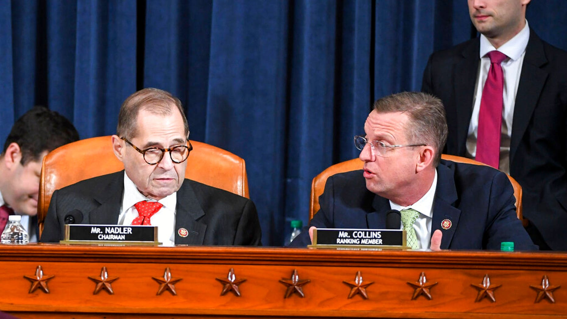 House Judiciary Committee ranking member Rep. Doug Collins, R-Ga., right, voices his displeasure after House Judiciary Committee Chairman Rep. Jerrold Nadler, D-N.Y., announced a recess at a House Judiciary Committee markup of the articles of impeachment against President Trump. (Jonathan Newton/The Washington Post via AP, Pool)