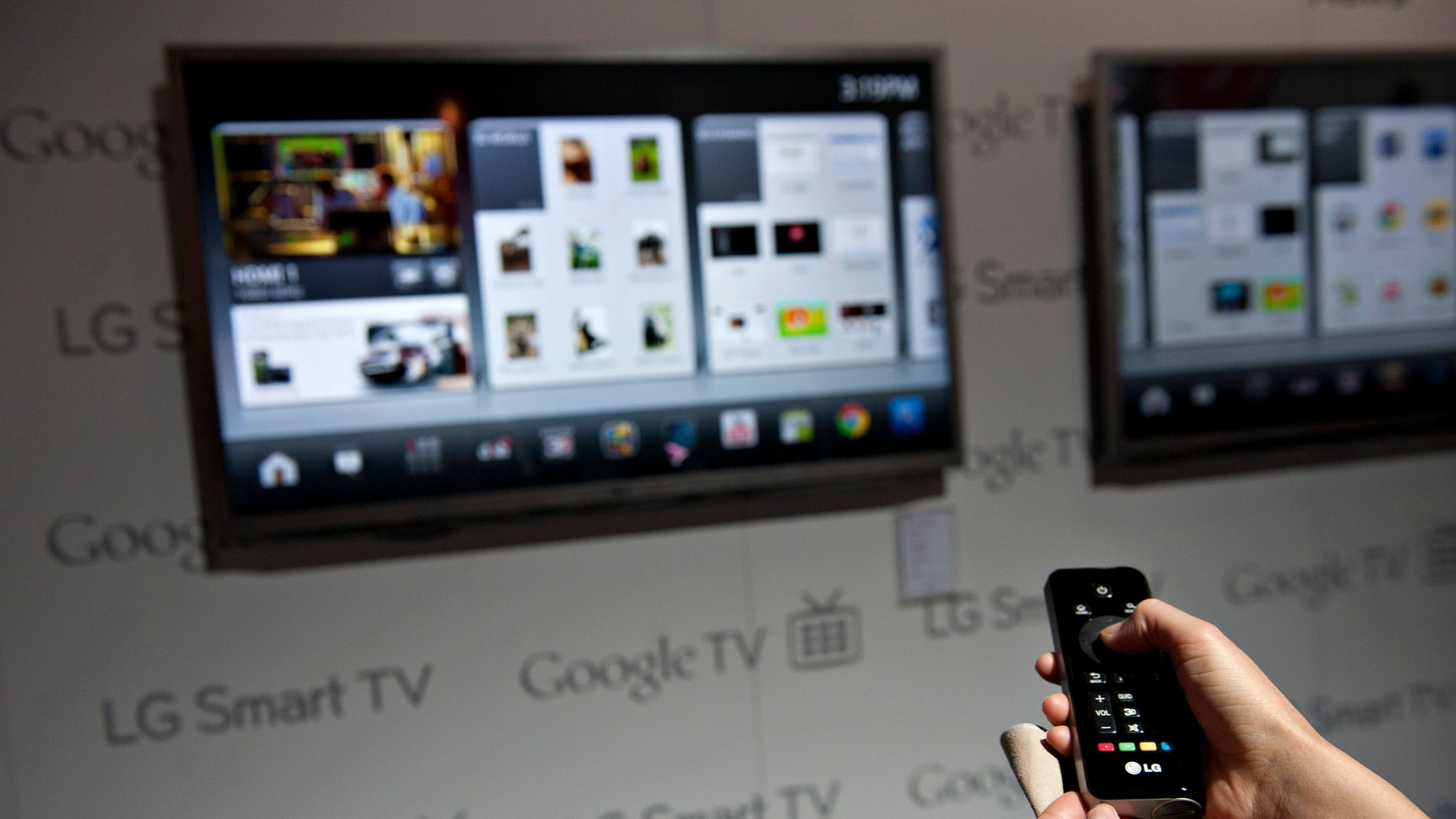 digital products A product demonstrator uses a remote control to navigate a menu on a LG Smart TV with Google TV at the 2012 International Consumer Electronics Show (CES) in Las Vegas, Nevada, U.S., on Wednesday, Jan. 11, 2012 - file photo.