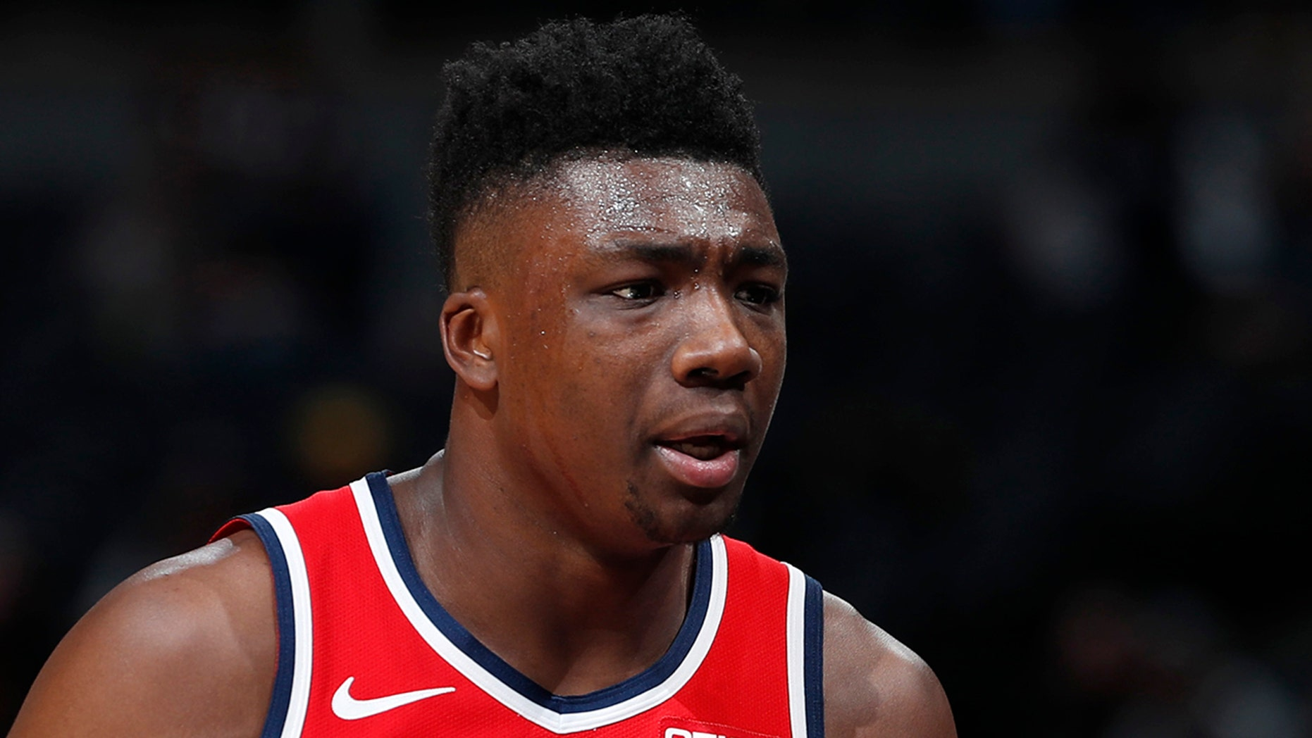 Washington Wizards center Thomas Bryant heads to the bench after drawing two quick fouls against the Denver Nuggets in the first half of an NBA basketball game Tuesday, Nov. 26, 2019, in Denver. (AP Photo/David Zalubowski)