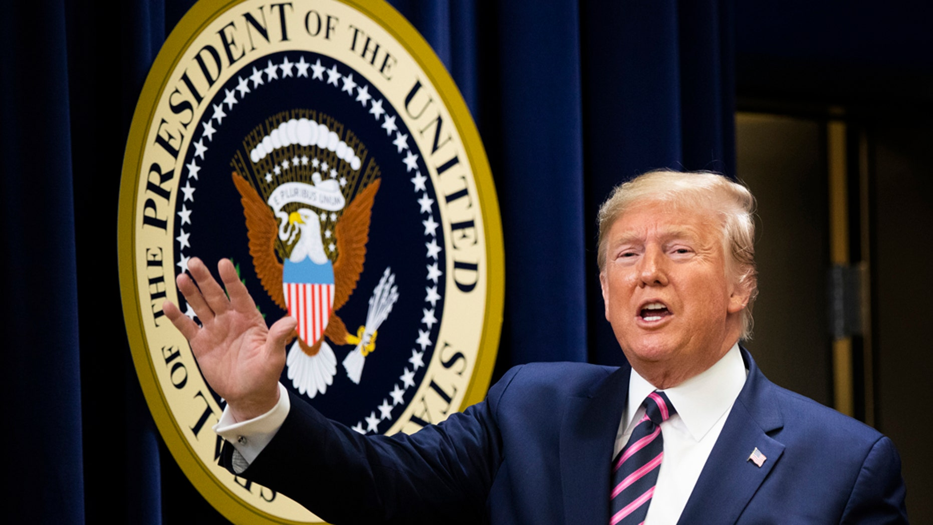 President Donald Trump waves during a summit on transforming mental health treatment to combat homelessness, violence, and substance abuse, at the Eisenhower Executive Office Building on the White House complex in Washington, Thursday, Dec. 19, 2019, in Washington. (AP Photo/Manuel Balce Ceneta)